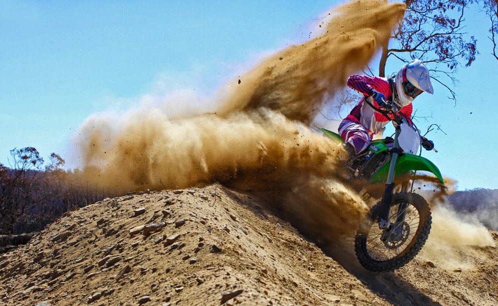 Nick Lean on the KX250F - berm exits stage left