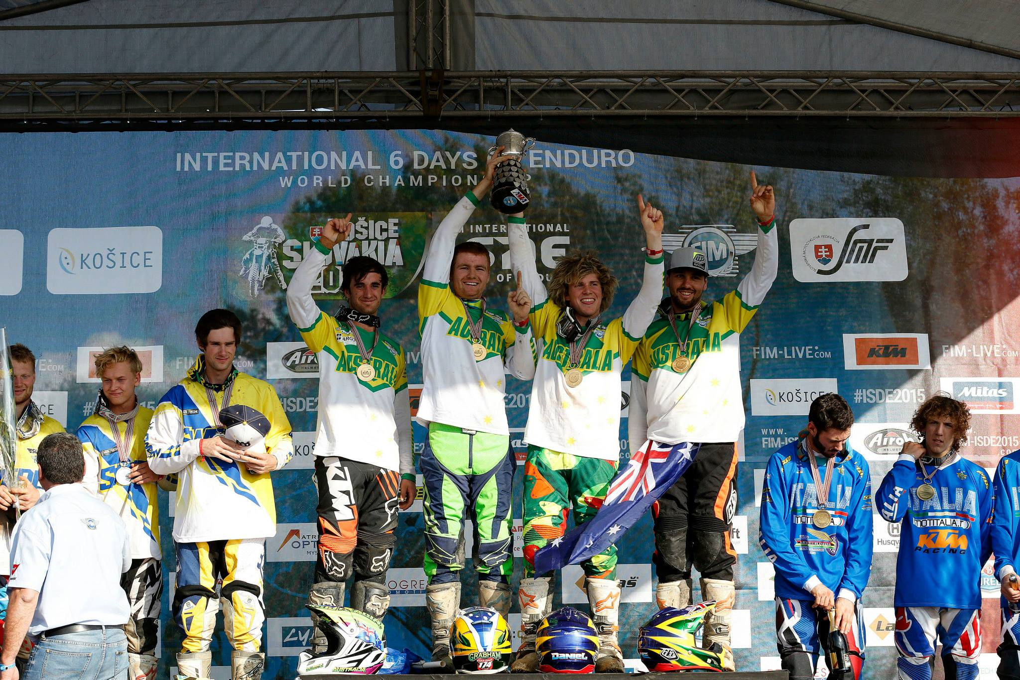 Aussie boys holding up the FIM Junior World Trophy