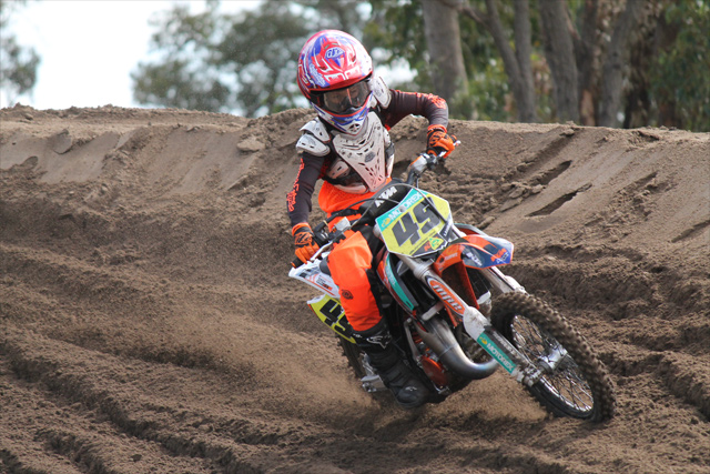 KTMs Jett Lawrence charged to a commanding qualifying race win today at Shrubland Park for the first official race day of the 2015 KTM AJMX. Image - Tenaya Smith - TS Photographics