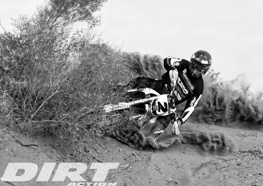 Jarrod Bewley blowing an Alice Springs sand hill apart on his 2012 Finke race bike