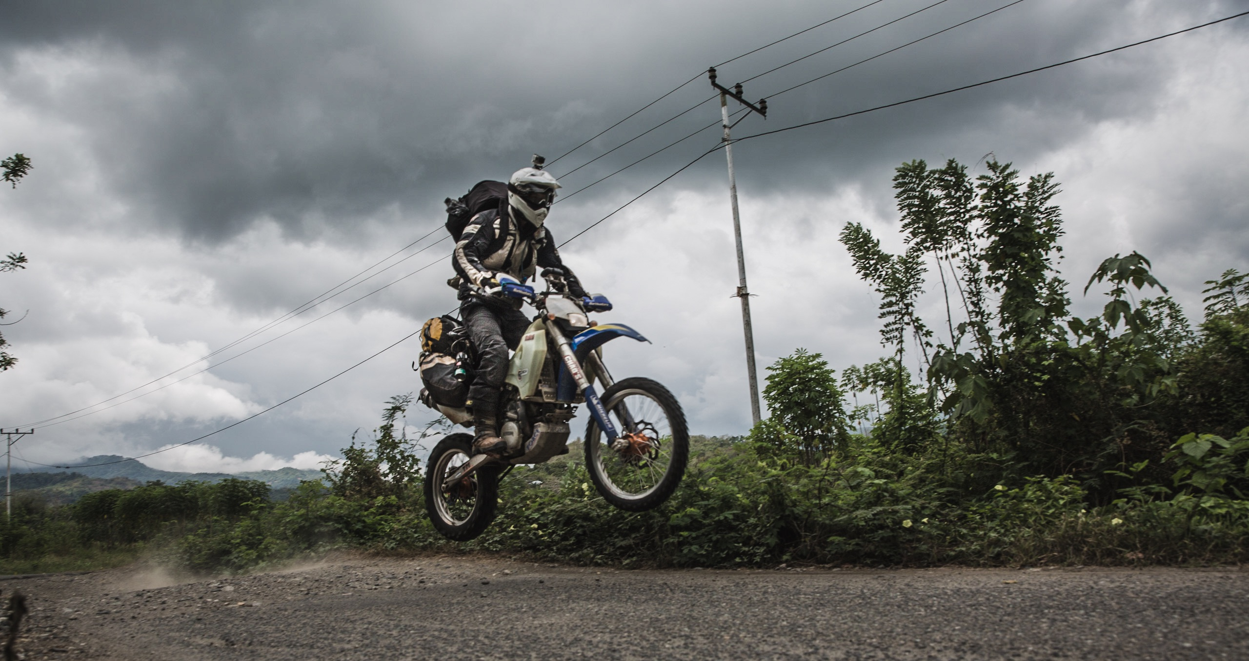 Alex and Josh from A New Man's Track making use of the road in Flores. The plastic sub-frame on the Husaberg FE450 is getting pushed to its limit.