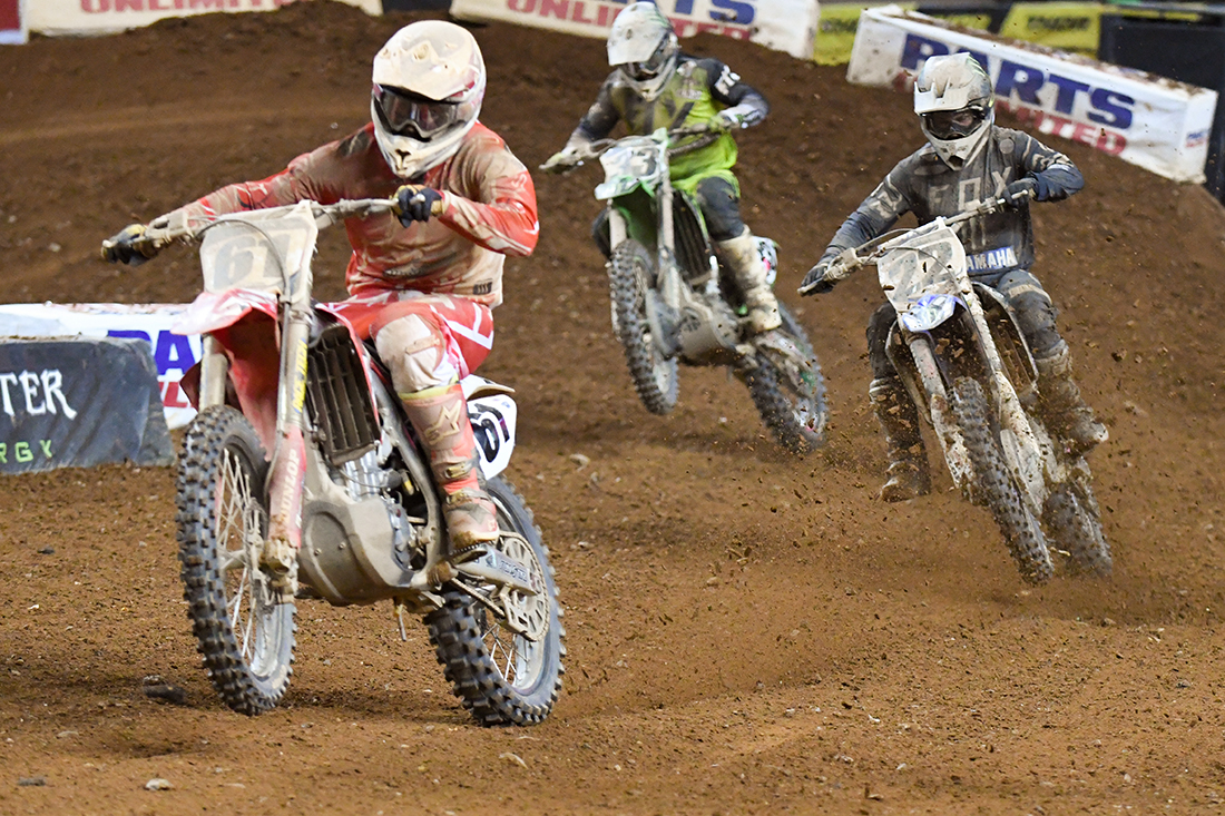 Vince Friese - Smartop Motorconcepts Honda Yoshimura, Chad Reed - Monster Energy Factory Yamaha and Josh Grant - Monster Energy Kawasaki driving down the straight during the Main Event  at the 2017 Monster Energy Supercross event in Atlanta.