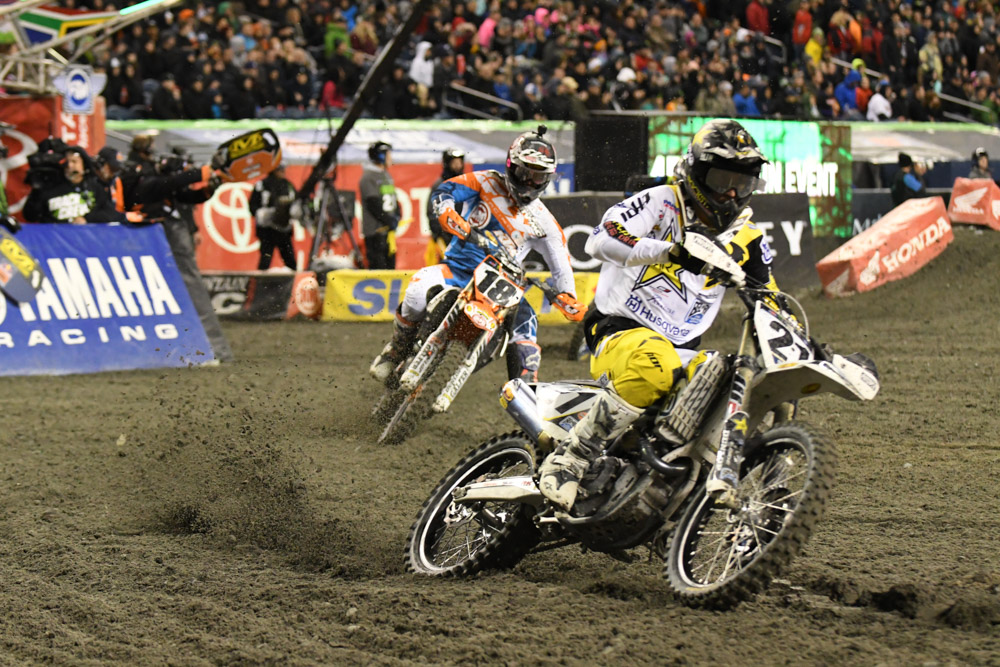 Jason Anderson - Rockstar Energy Husqvarna Factory Racing leads David Millsaps - Rocky Mountain ATV/MC KTM at the Seattle Monster Energy Supercross.
