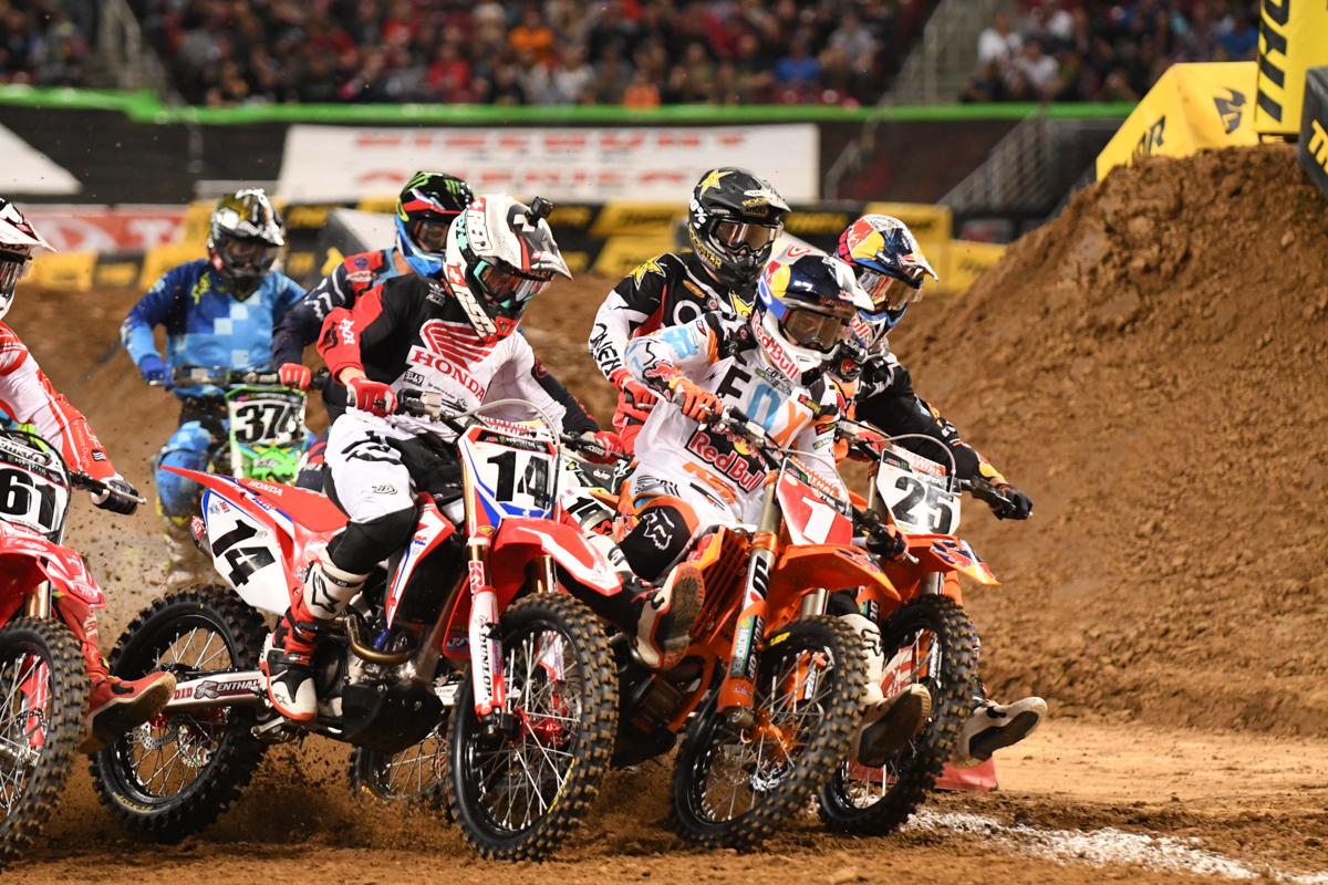 Ryan Dungey - Red Bull KTM inches out the lead in the wipe sweeper first turn at the St Louis Monster Energy Supercross.