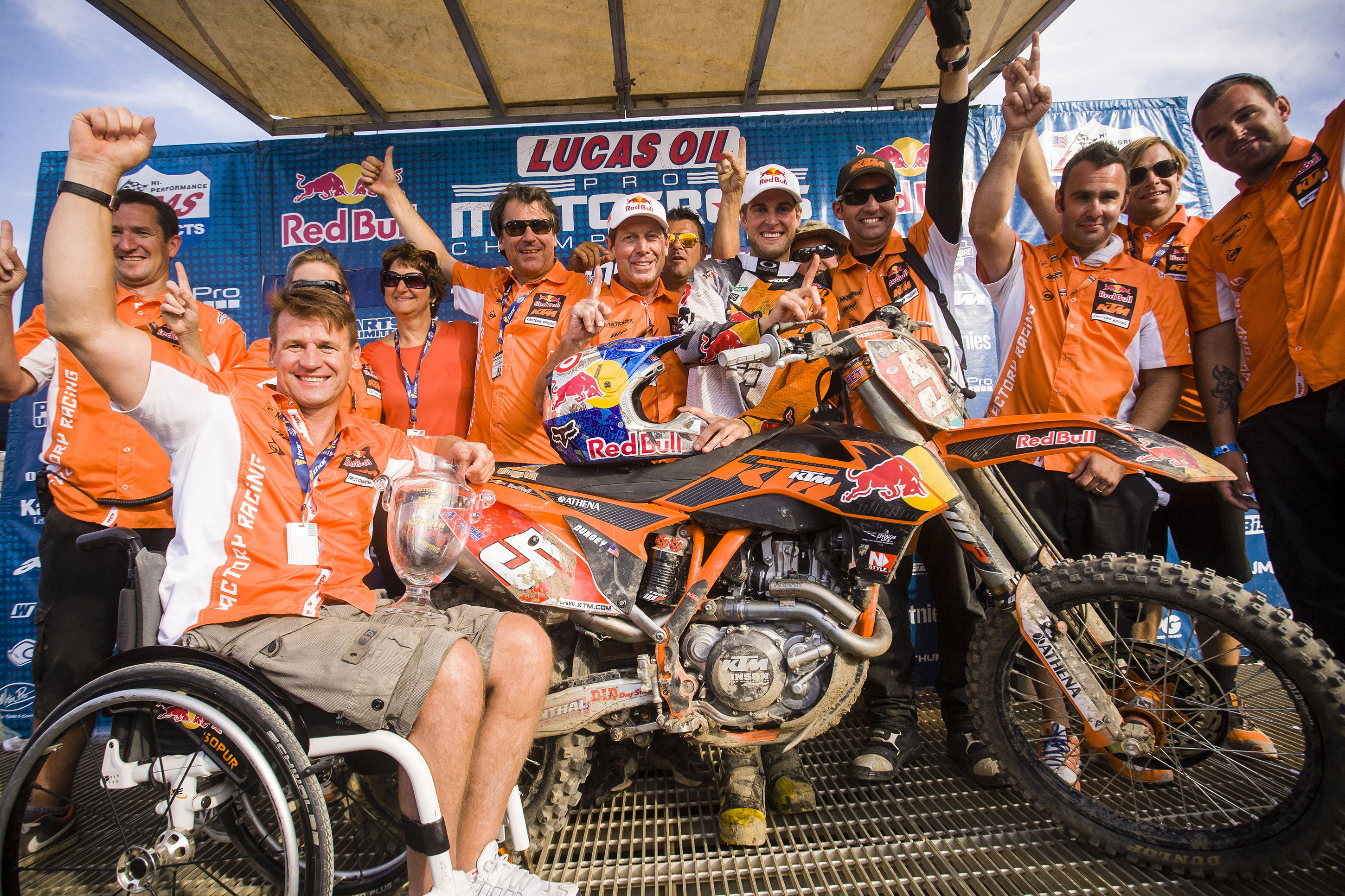Ryan Dungey and KTM USA team members pose for a winners portrait at the AMA Pro Motocross Championship 2012 at Lake Elsinore in California, USA on September 8th, 2012 // Frank Hoppen / Red Bull Content Pool // P-20120910-00120 // Usage for editorial use only // Please go to www.redbullcontentpool.com for further information. //