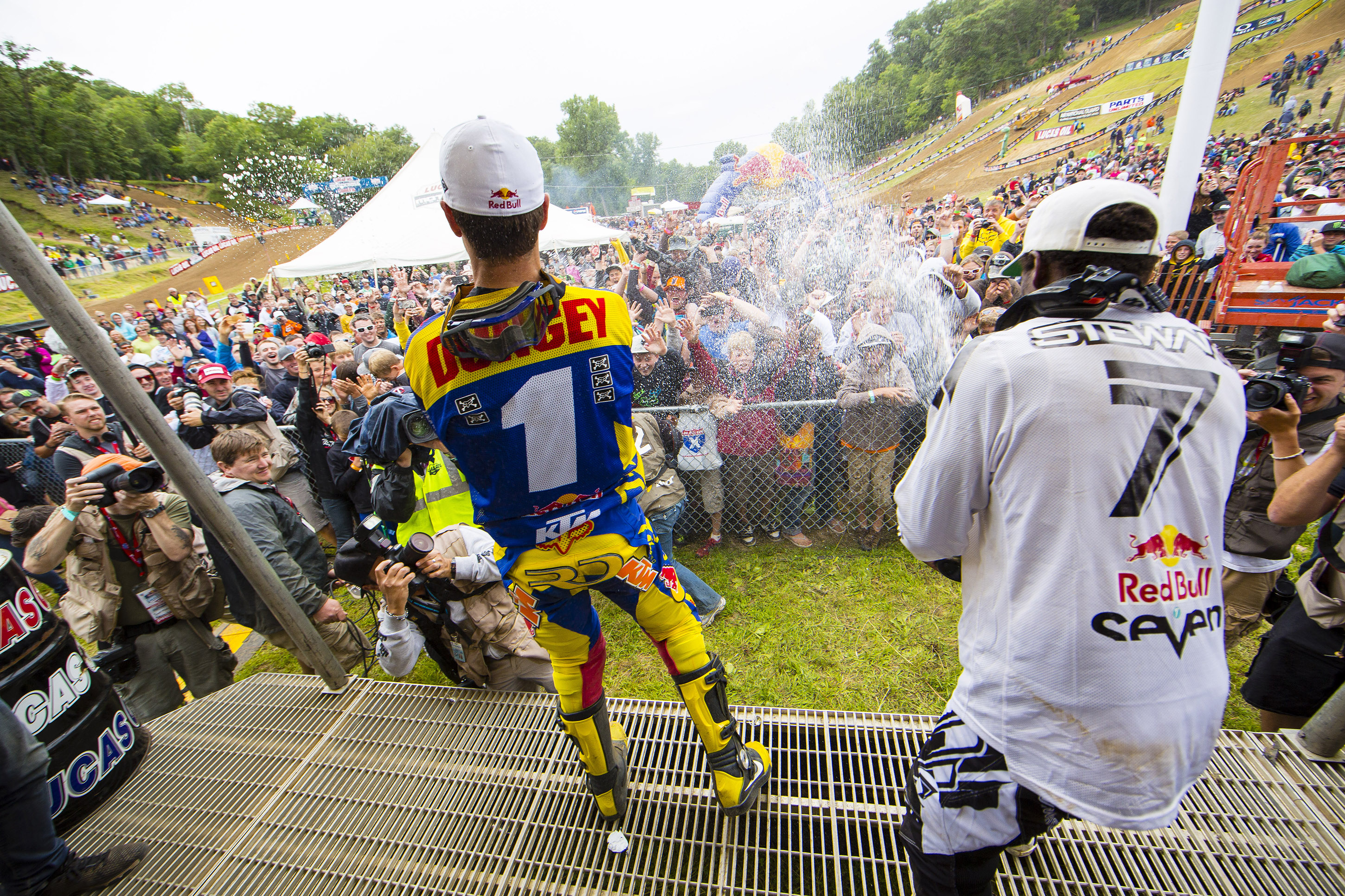 (L-R) Ryan Dungey and James Stewart celebrate at the Lucas Oil AMA Pro Motocross Championship at Spring Creek MX in Millville, Minnesota, USA on 27 July, 2013. // Garth Milan/Red Bull Content Pool // P-20130729-00275 // Usage for editorial use only // Please go to www.redbullcontentpool.com for further information. //